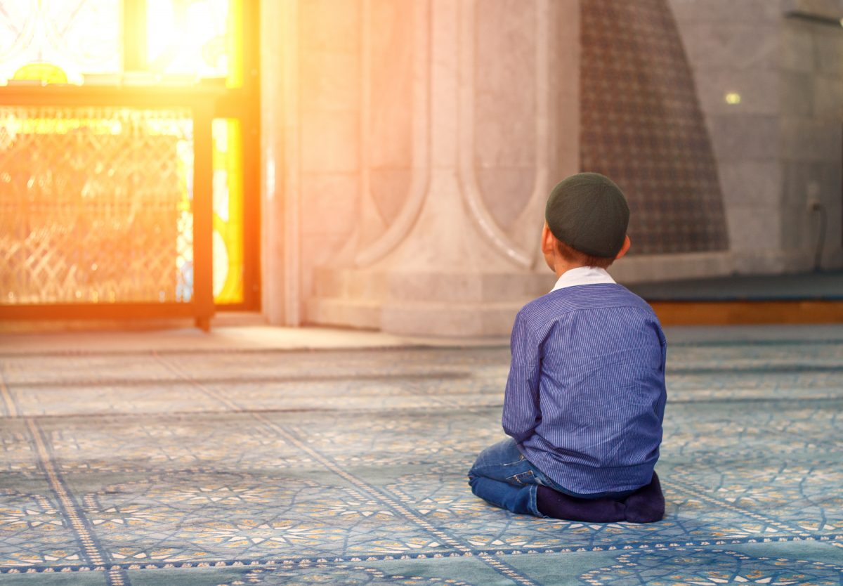 a little boy in the mosque